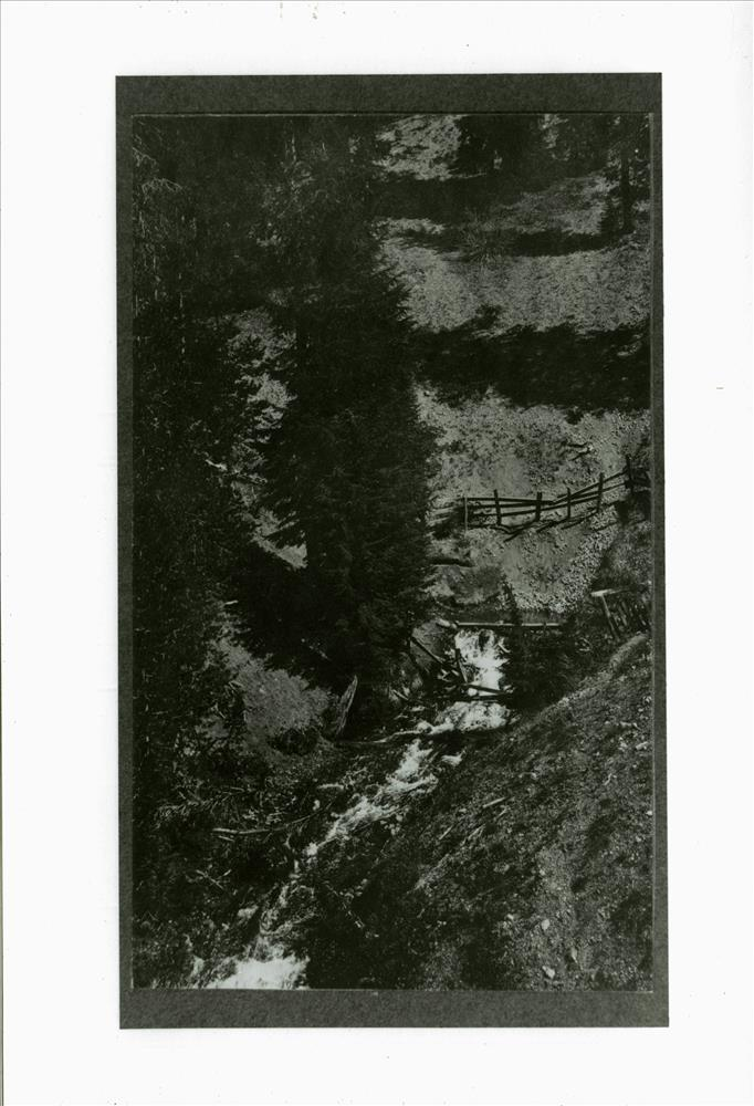 Annie Spring in Crater Lake NP, circa 1910 taken before spring enclosed, but utilized by park headquarters and Camp Arant, Parkhurst Collection