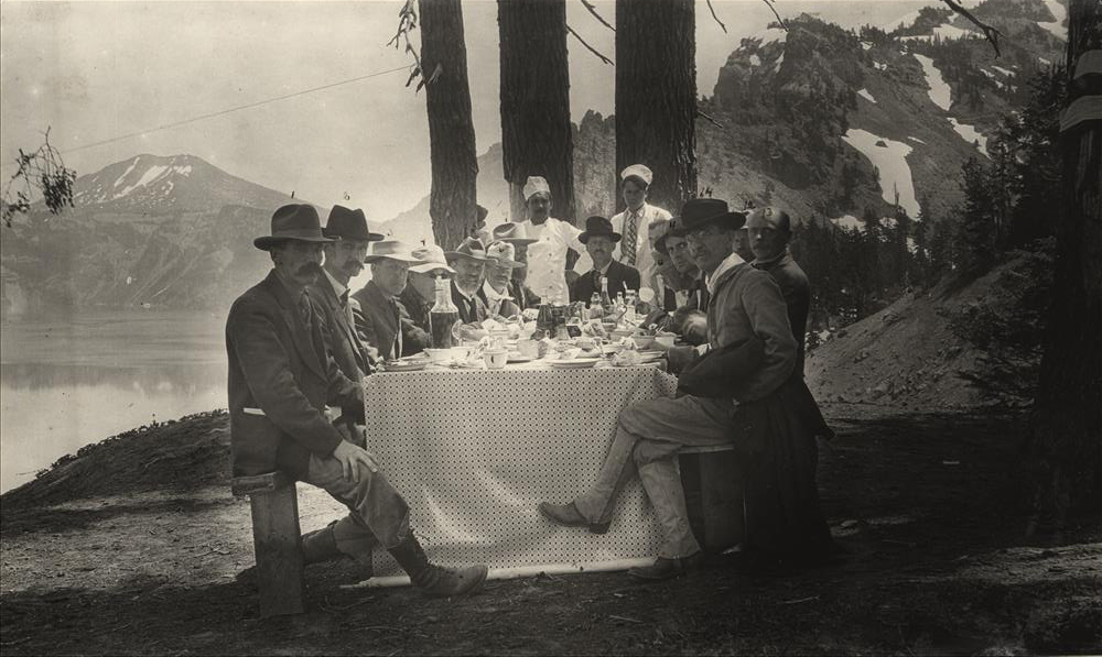 1907      Secretary of the Interior under President T. Roosevelt, James R. Garfield, the third son of President James A. Garfield, (4th on left) proved himself to be a hardy bather during a buggy ride to Crater Lake by swimming both in the Rogue River near Natural Bridge and by dipping in the sapphire-blue waters of the Lake itself. (Medford Daily News)