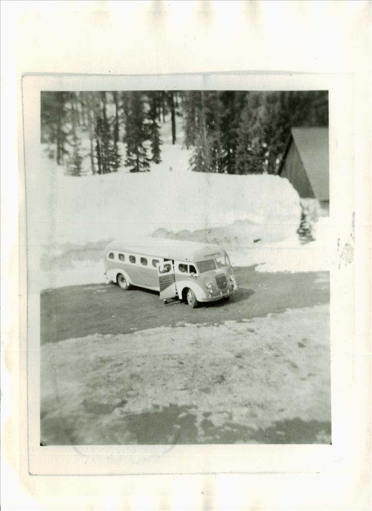 Bus bound for ski jump at south entrance to Crater Lake NP, 1938