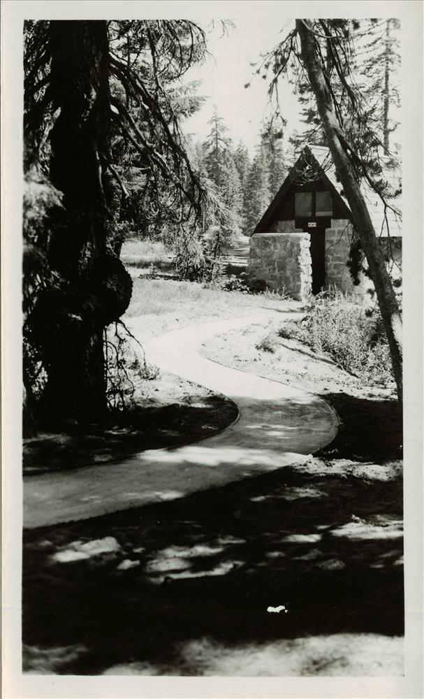 Emulsified asphalt walk leading to comfort station between Ranger Dorm and Mess Hall in Crater Lake NP, 1937 CCC Project