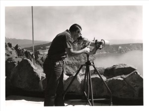 Fire Guard Larry Knapp checking out binoculars on The Watchman Photographer Tom Cooper 1965