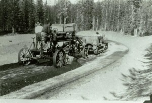 Grader used to apply surfacing material in Crater Lake NP, circa 1930 possibly Pinnacles Road