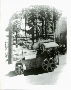 Guy Hartell and steamroller in Crater Lake NP, circa 1938 Hartell collection
