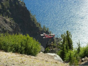 Helicopter close to caldera wall in Crater Lake NP, 2010