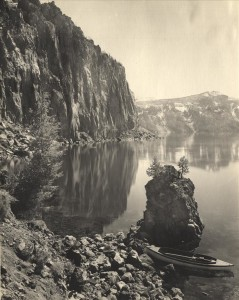 Lake Shore in Crater Lake NP (date unknown) Taken from shore, Cloudcap and faint Mount Scott in background; may have been taken from Steel Bay; Kiser black and white photograph
