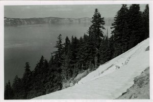 Men shoveling snow from lakeside trail in Crater Lake NP, July 1956