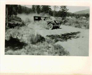 Old Flint auto in pumice dust on East Entrance Road in Crater Lake NP, 1920s