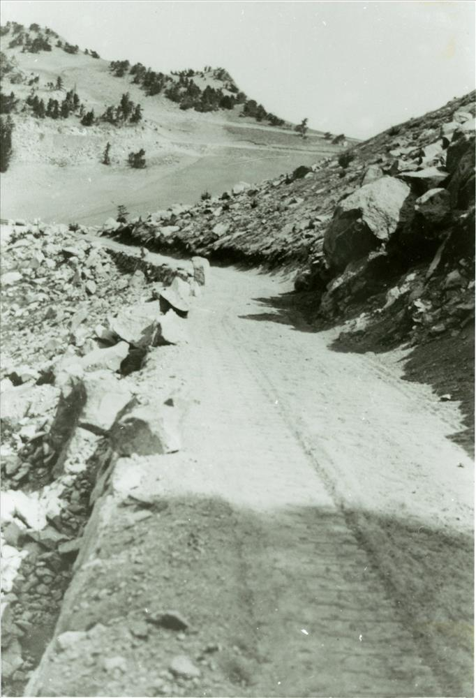Old Rim road tunneled by the CCCs at The Watchman in Crater Lake NP, circa 1933