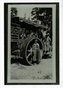 On the roller, used for compacting the road surface on Rim Drive in Crater Lake NP, 1917 Parkhurst collection
