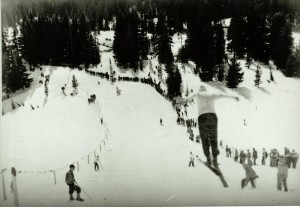 Ski jumper in flight north of Park Headquarters in Crater Lake NP, circa 1931-1932