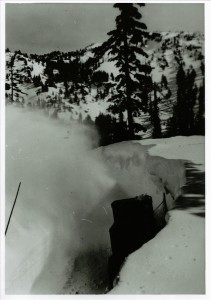 Sno-go at work on road between Park Headquarters and Rim Village in Crater Lake NP with a portion of Garfield Peak (Castle Crest) visible, circa 1931-1932