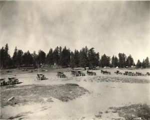Tent camping at Rim Village; Picnic Hill in background; cabins in far right background; sign for Kiser's studio at the Rim in center of middle ground 1925