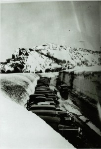 Vehicles parked along the Rim Village roadway, Crater Lake Lodge and Garfield Peak in the distance, circa 1931-1932