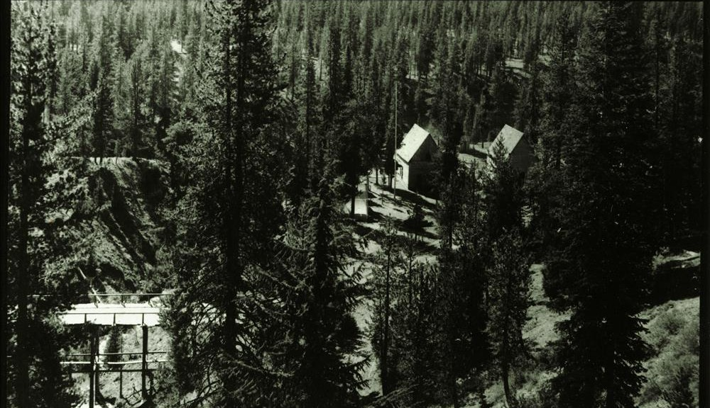 View of Camp Arant (park headquarters) from a spot on the old military road just above Annie Spring in Crater Lake NP (date unknown)