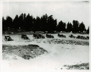Visitors in the rim parking area and Rim campground in background in Crater Lake NP, 1918-1919