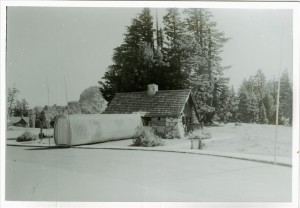 Winter entrance to plaza comfort station in Crater Lake NP, circa 1960