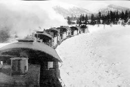 Five locomotives push a wedge plow to clear the tracks in January 1914.