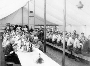 Lumberjacks eat in a mess tent at the McCloud River Lumber Company around 1905.