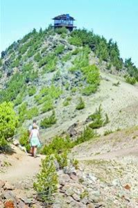 Hikers climb to the lookout atop Mt. Scott, the park's highest point.