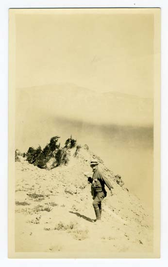 "Aug 1921, Snowballing at Crater Lake, historic photograph Black and white print, 1921 5 1/4 x 3 1/4 inches This digital image is a scan of a black and white print. The original print is located in the Crater Lake Institute's collection of historical artifacts. The back of the print reads, ""Printed in Artura, Ransford 312-13 Stock Ex. Portland, Ore."" and (handwritten), ""Aug 1921, Snowballing at Crater Lake"""