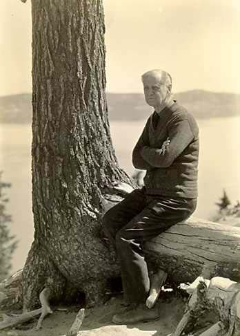 Portrait of Mt. Steel, historic photograph 1929 Photographer: Harvey Stork Image source: NPS Historic Photograph Collection (online) at Harper's Ferry web site. Description: Portrait of Mr. Steel seated on base of only surviving tree around which ropes were snagged to launch first boats. (William Gladstone Steel was an early proponent for the creation of Crater Lake as a National Park) Catalog Number: HPC-000194