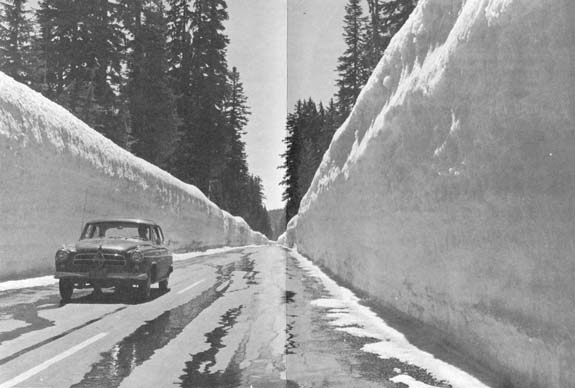 High Snowbanks Along the Road to the Rim, historic photograph 7 1/4 x 5 inches This image is a scan of a print from a Department of the Interior, Crater Lake National Park brochure, 1965. The brochure is part of the Crater Lake Institute's collection of historical items.