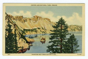 Title: Crater Lake National Park, Oregon, Phantom Ship From Dutton Cliff Card Number(s): 877, 7A-H987 Publisher: Wesley Andrews Co., Portland, Ore.