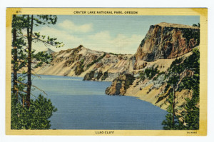 "Title (front): Crater Lake National Park, Oregon (top, center) Llao CLiff (bottom center) Postmark: None, unmailed Stamp: ""Place one cent stamp here"" box Post Card Era: Linen Description Back caption: The encircling lava walls, jagged and exquisitely colored, tower 2000 feet above the lake, itself 2000 feet deep, and is one of the deepest and by far the bluest water lake in the world. The face of Llao Rock is the highest vertical surface on the Rim, being 1997 feet above the surface and 8046 feet above sea level. Crater Lake is six miles long and four half miles wide. Vertical Divider Text (back): ""C.T. ART-COLORTONE"" REG. U.S.PAT.OFF.--WESLEY ANDREWS CO., PORTLAND, ORE. Card Number(s): 871 (front upper left corner), 7A-H982 (bottom right corner)"