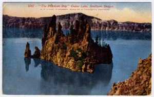 "Title: ""The Phantom Ship"" Crater Lake, Southern Oregon (front, center-top) S. P. LINES IN OREGON, ROAD OF A THOUSAND WONDERS (front, center top, below main title above) Postmark: APPLEGATE, OREGON, JUL 14, 1914, A.M. Stamp: Removed previously. Vertical Divider Text (back): None. Vertical line only. Card Number(s): 3202 (front, upper left) Publisher: Published by Edw. H. Mitchell, San Francisco (back, bottom-left)"